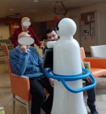 Interaction between a robot and an elderly person.