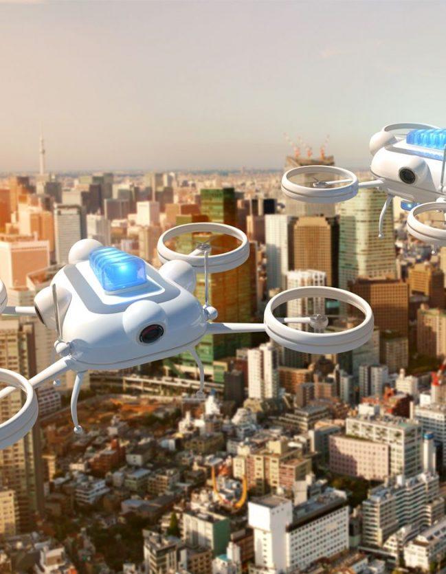 Objets connectés de type drônes survolant la ville.