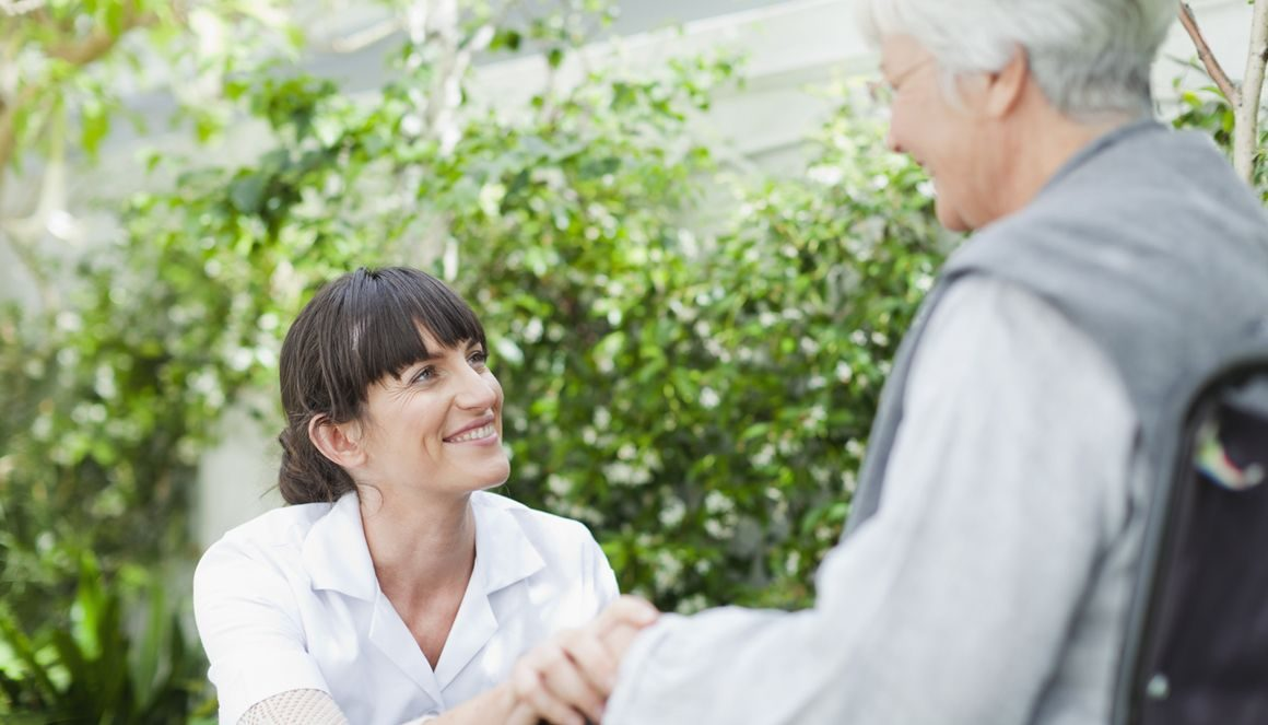 Home help accompanies a senior citizen.
