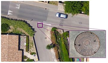 Software detection of a sewer plate.